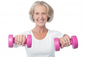 Older woman holding weights